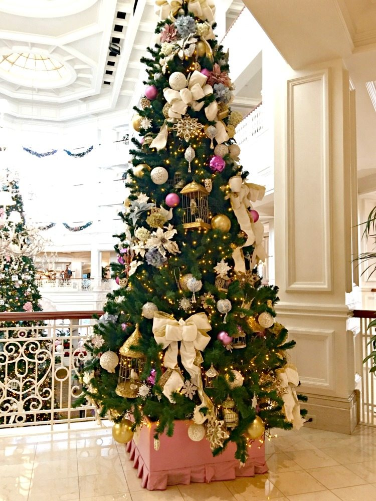 Christmas trees filled with victorian decorations of bows, bird cages, flowers and more.