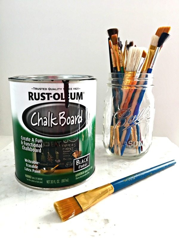 Chalkboard paint and artist paint brushes to make a chalkboard