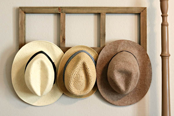 how to organize your home and stay organized by hanging hats on hooks