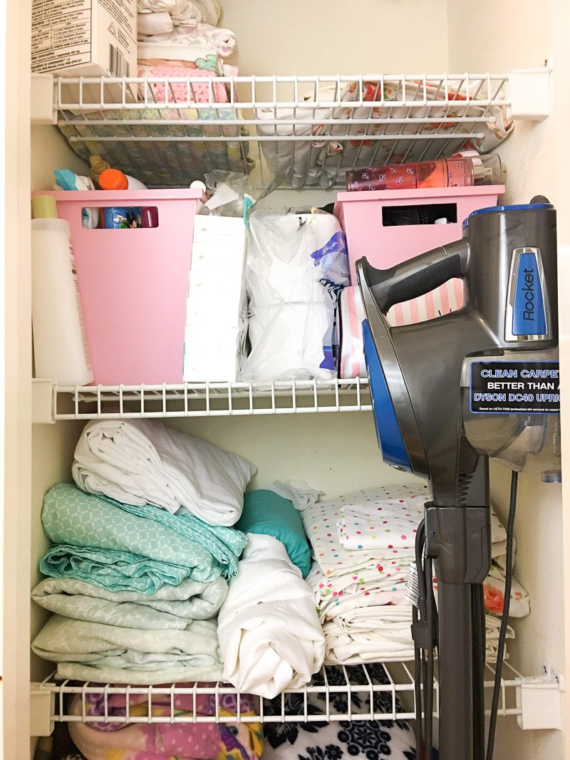 Messy linen closet that needs organizing