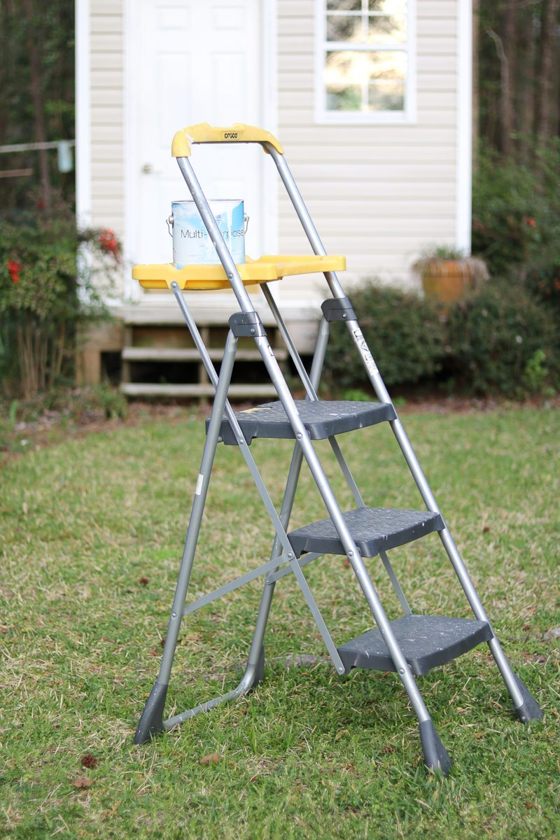 best painting tools is a platform ladder shown here holding a can of Sherwin Williams paint.