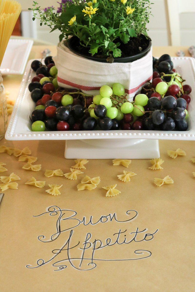 Italian Dinner Party Styling Inspiration brown craft paper runner with Buon Appetito written on the table.