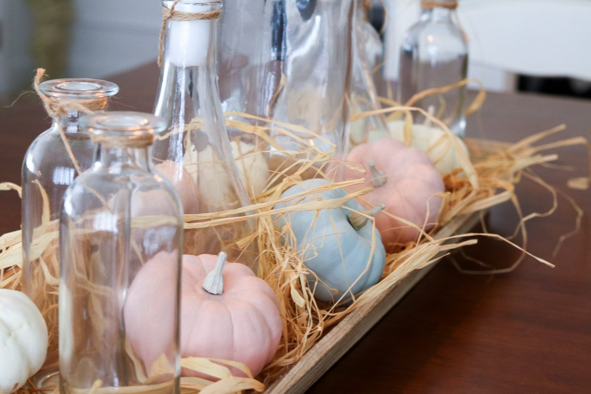 Farmhouse pumpkin centerpiece glass bottles
