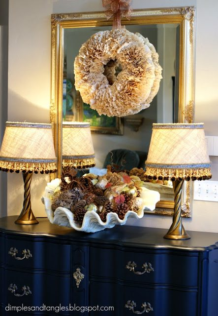 fall wreath ideas coffee filters and hung on a mirror inside a home.  This beautiful wreath is made my Dimples and Tangles