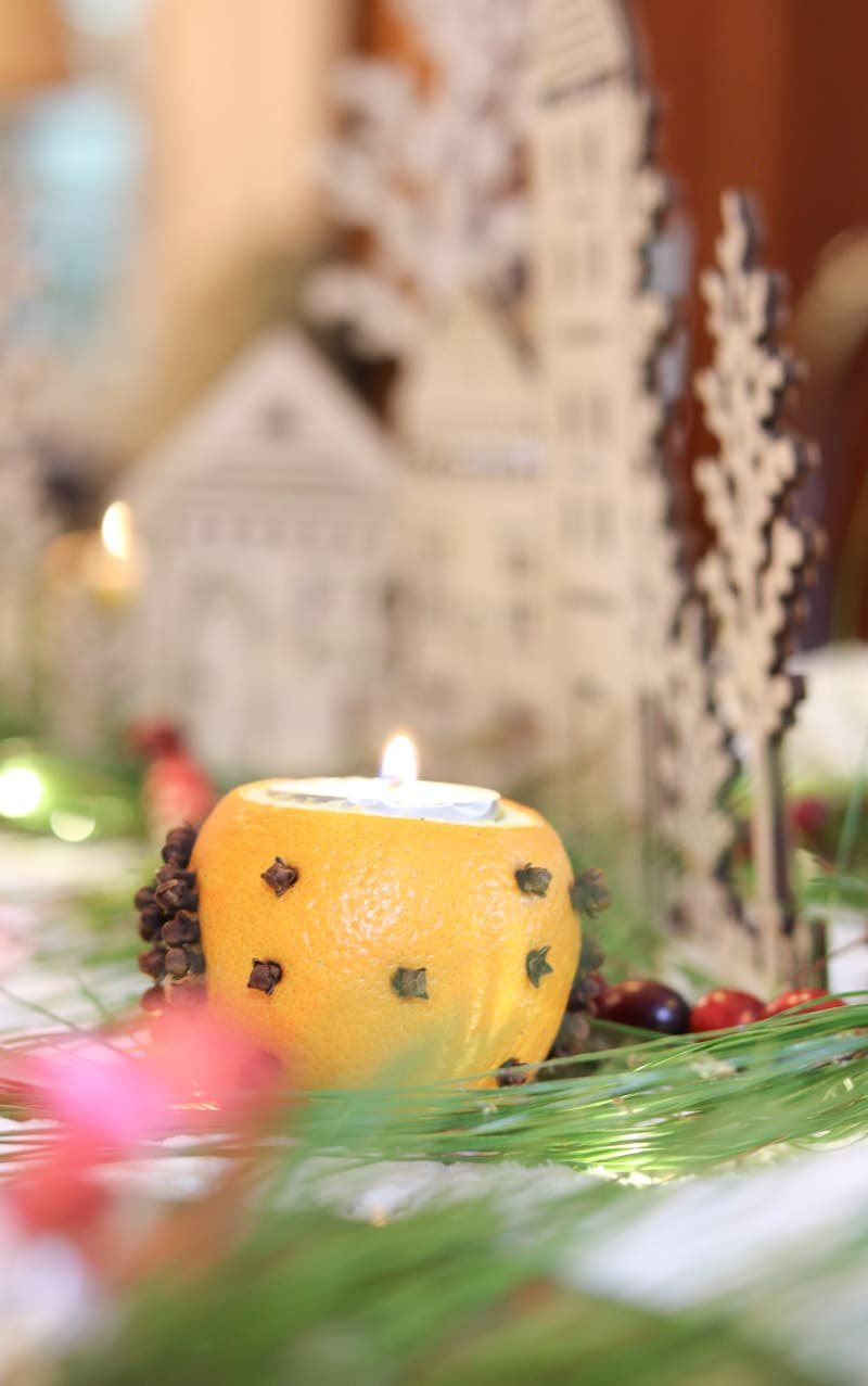 Festive tablescape orange and clove candle