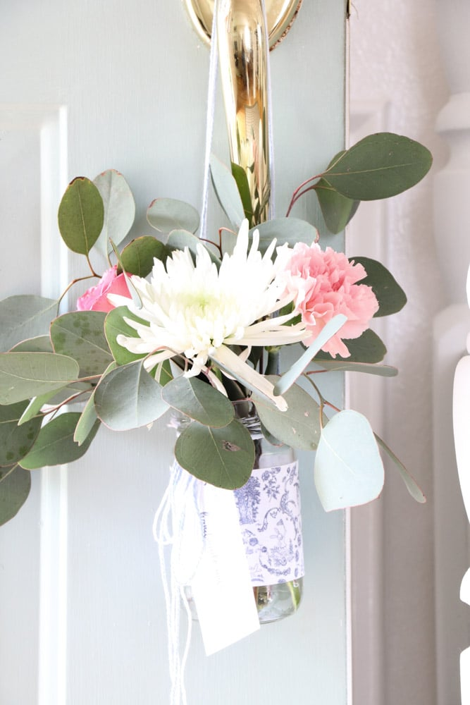 diy printable ideas for home decorating  using a toile pattern printed on paper and attached to a vase for flowers.