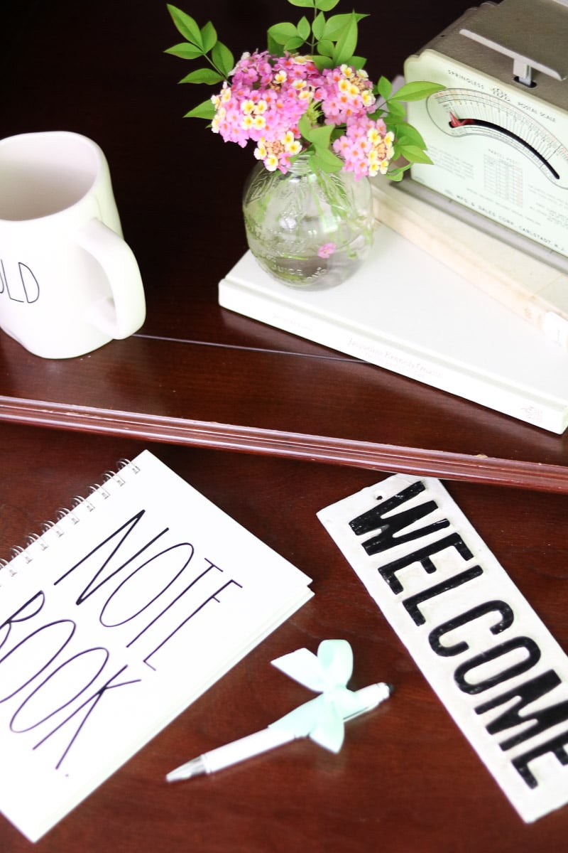 Decorating with vintage scales in the office using flowers and books