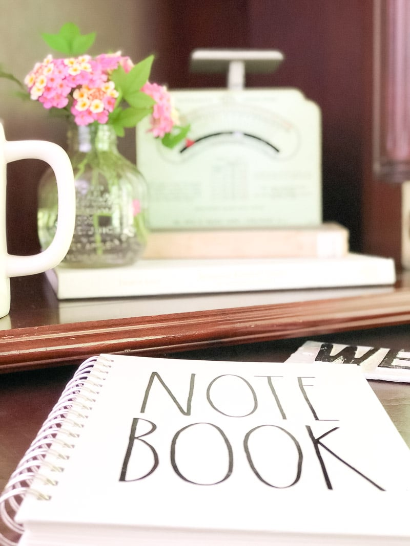 decorating with vintage scales in an office with flowers and rae dunn notebook