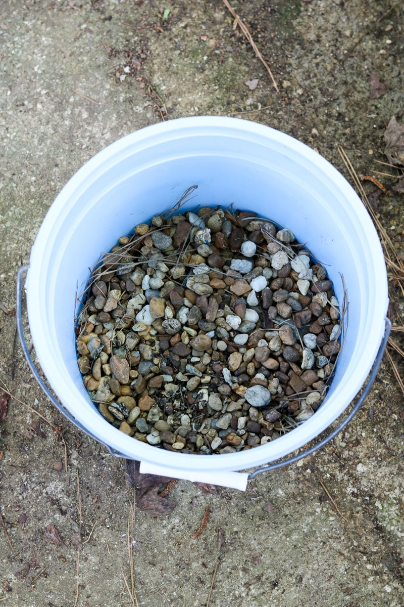 Container flower gardening rocks in the bottom of the pot