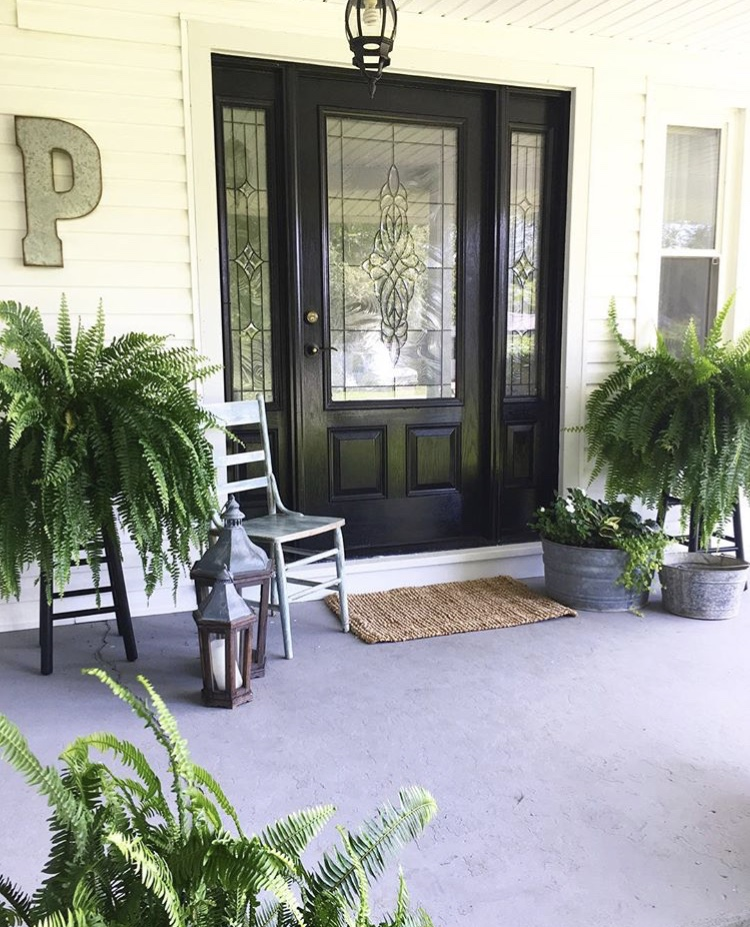 Modern Front Doors by Two Hens Styling And Design with a black front door with windows in and beside door on a white home and a metal P monogram letter