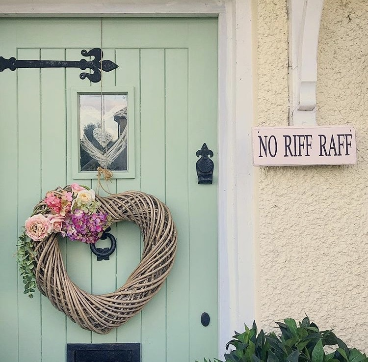 "Modern Front Doors by Sugar Print Fairy with a light green front door and a grapevine heart wreath and a wooden sign that reads ""no riff raff"""
