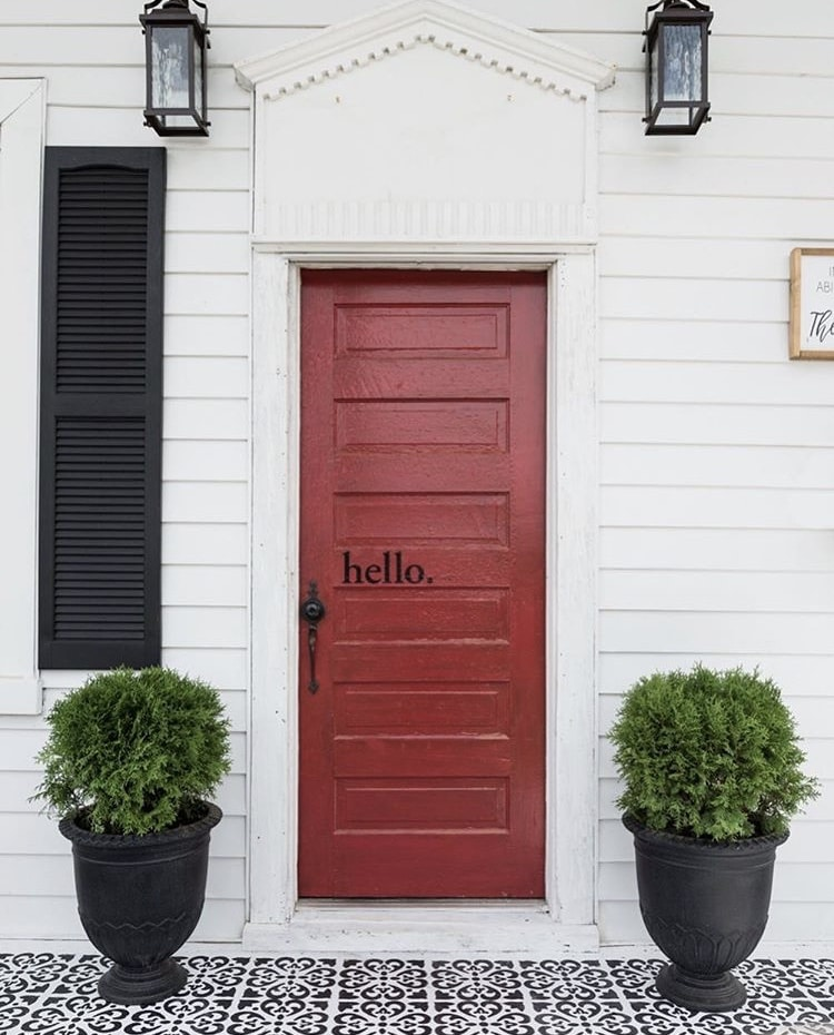 "Modern Front Doors by The Morris Manor with a red door on a white house with red vinyl letters that read ""hello."""