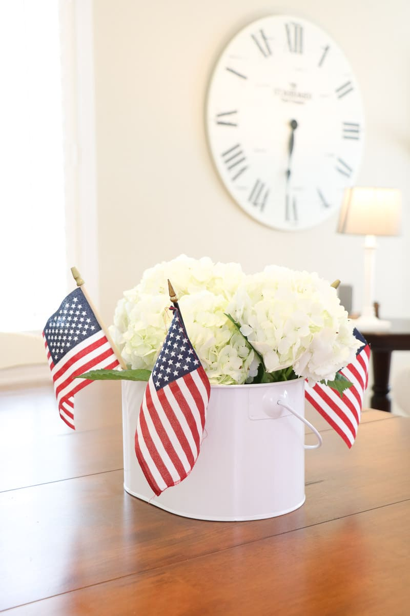 4th of July decorating ideas with a tin of hydrangeas and small American flags