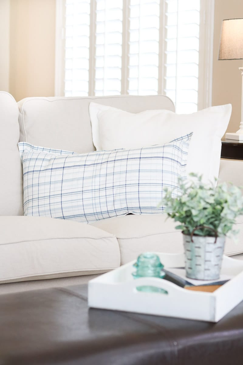 4th of July decorating ideas in the living room with blue and white pillows