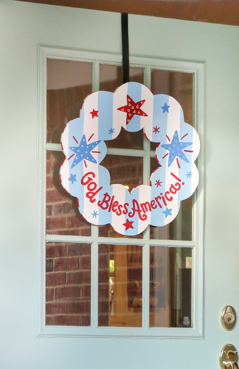 4th of July decorating ideas on a small front porch with patriotic Coton Colors wreath