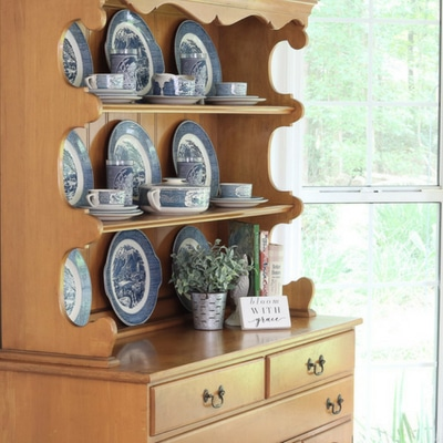 Storing and displaying on a farmhouse hutch