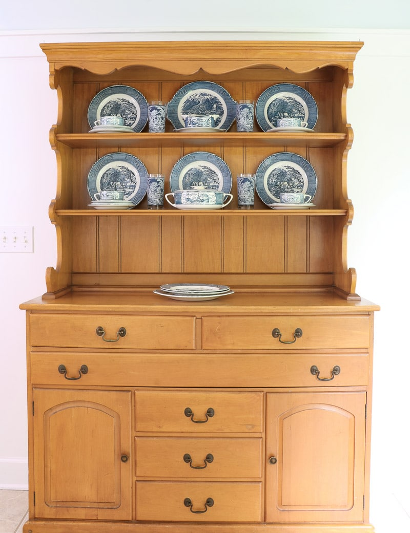 Place Currier and Ives glass between dinner plates on the farmhouse hutch