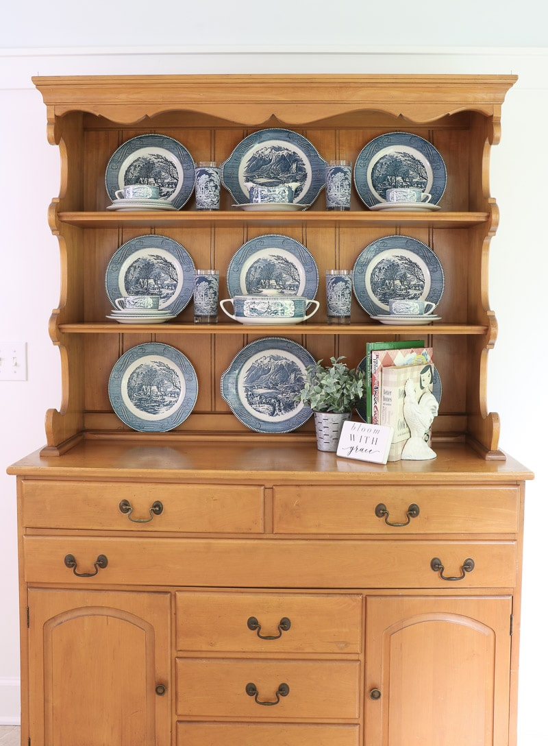 Currier & Ives ironstone dishes on a farmhouse hutch