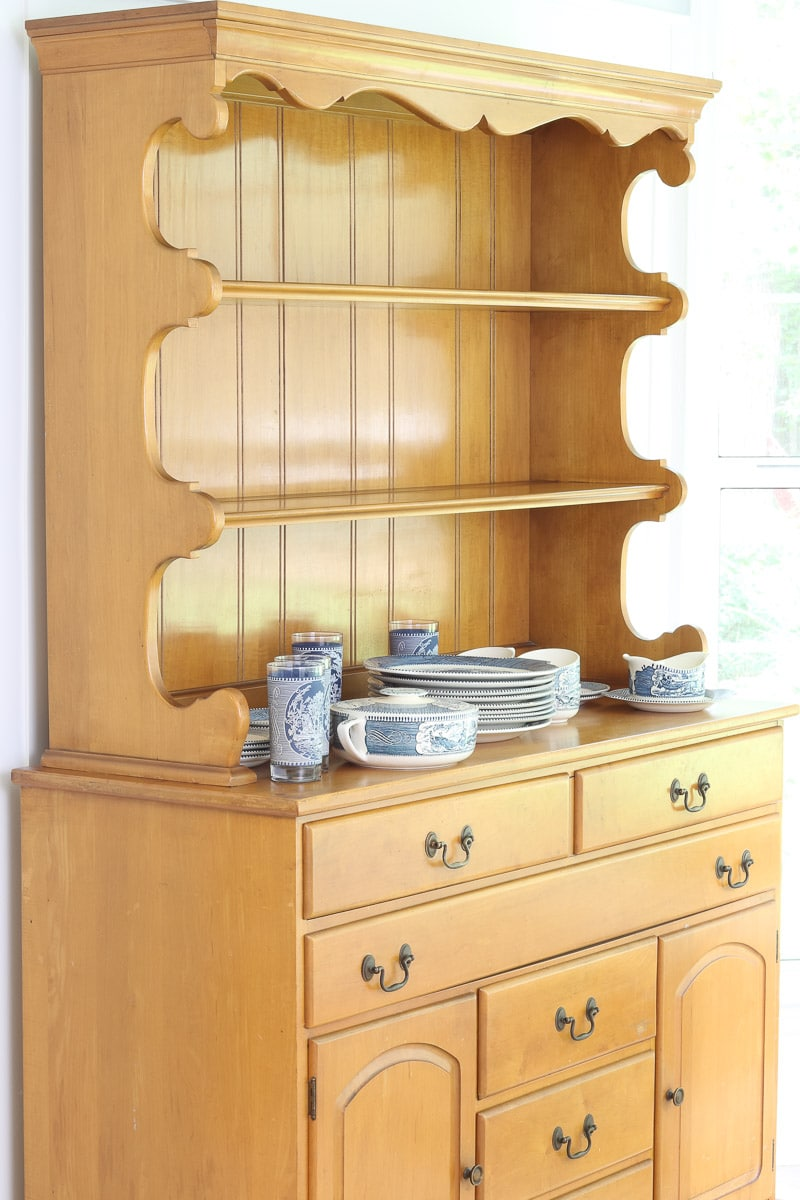 Farmhouse hutch ready for storing and displaying Currier and Ives dishes