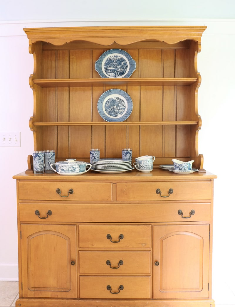 Larger ironstone pieces in the middle of the farmhouse hutch