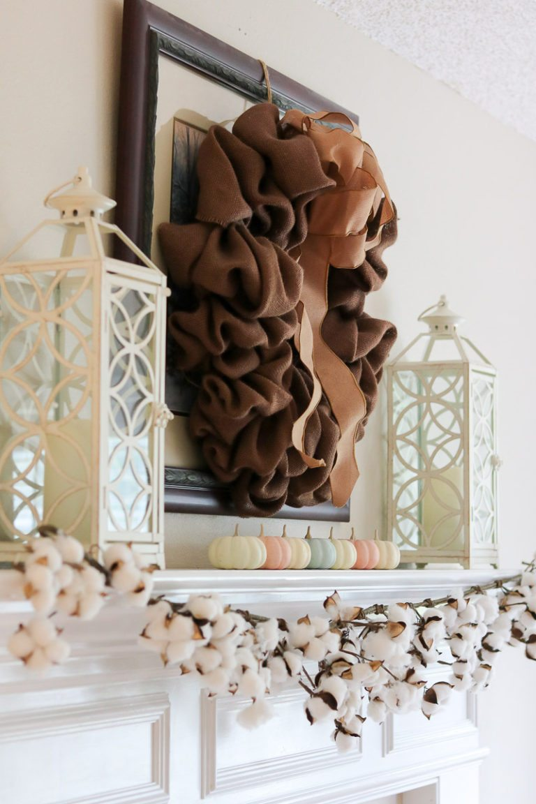 Decorating mantle with small pumpkins