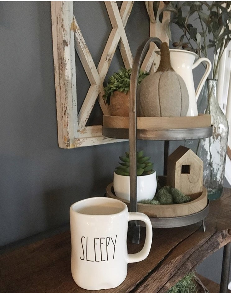 Fall Decor tiered tray by Gnarled Knot. Her modern farmhouse look includes a metal pitcher, felt pumpkin, succulents and a adorable wooden house.