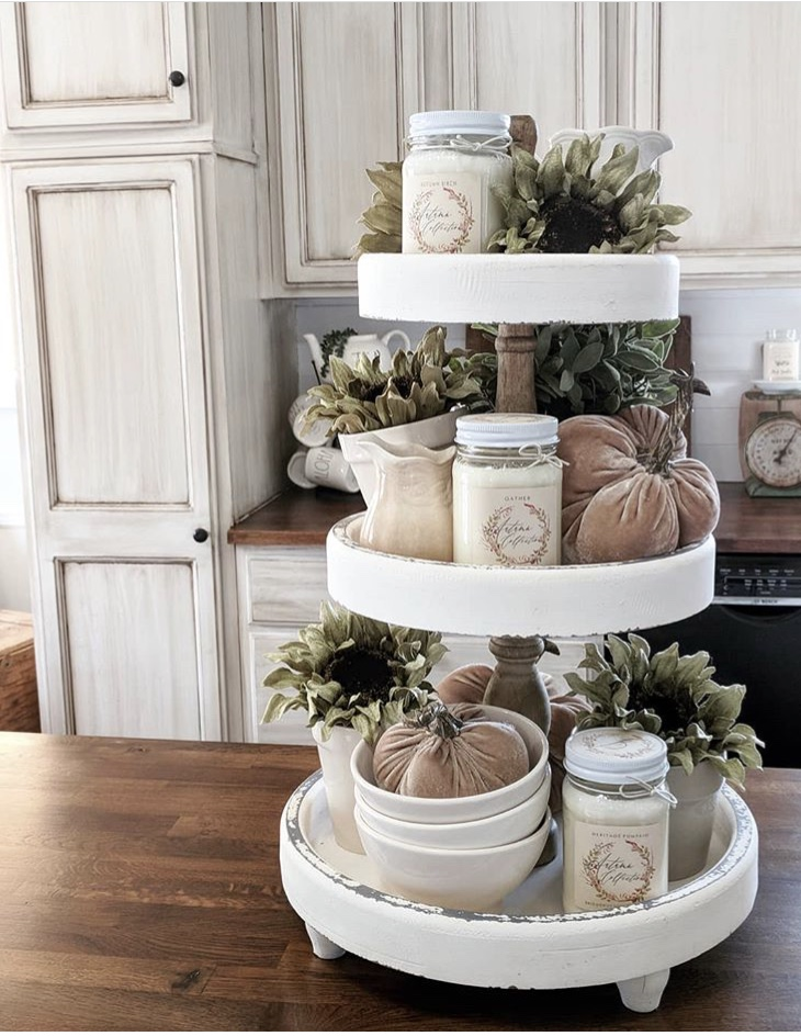 Fall Decor white cottage feel tiered tray by Down Shiloh Road. Her lovely tray is filled with jar candles, loads of green sunflowers, velvet pumpkins and white dishes.