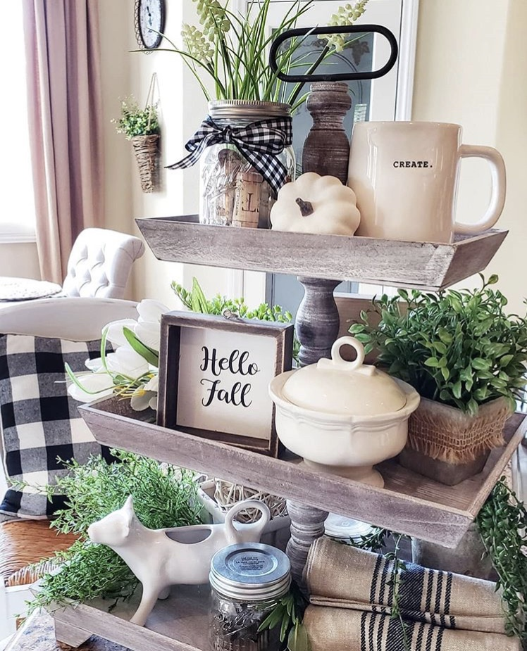 Fall Decor rectangle distress wood tiered tray by Blessed at Home. So many wonder ides on these trays. Each layer holds plants, Rae Dunn coffee mug, white pumpkin, Hello Fall sign, vintage dish towels, mason jars filled with corks and a sweet cow creamer.