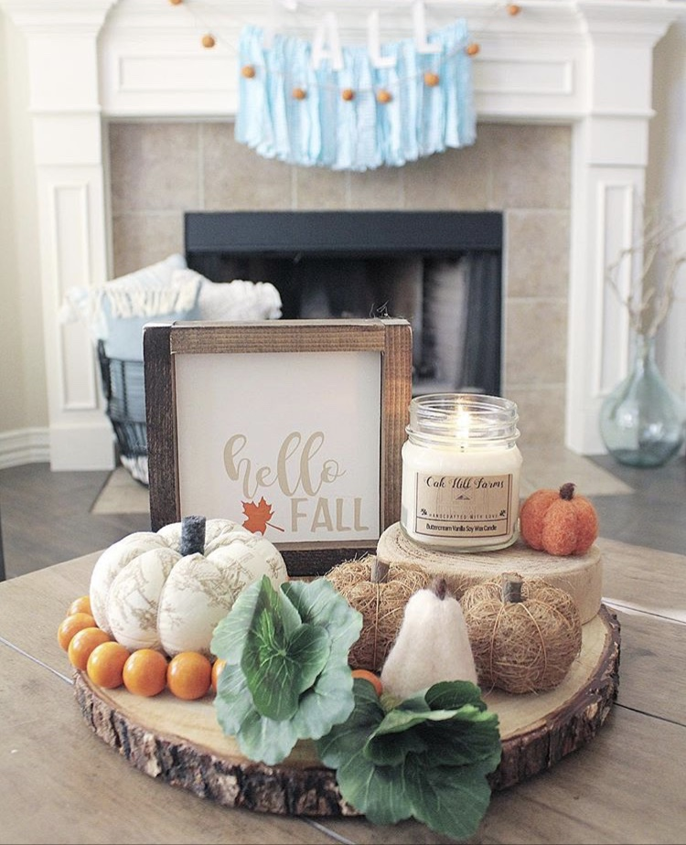 Fall Decor wood cutting one tier tray by Table for 5 Please. This sweet layer of wood holds some beautiful pumpkins in different textures, cabboge and surrounded by some orange beads,. Tiers are created with other layers of wood to hold a candle and a Hello Fall sign.