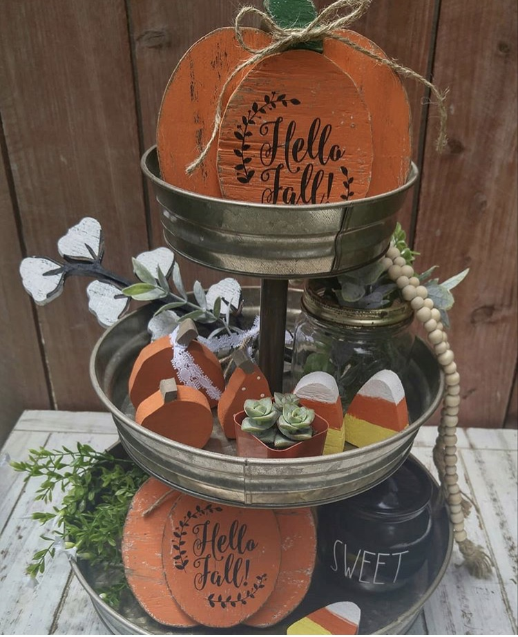 Fall Decor tiered tray by Scissors In Bloom. Her tray is filled with lots of orange colors with wooden pumpkin, candy corn, cotton, plants and a touch of Rae Dunn.
