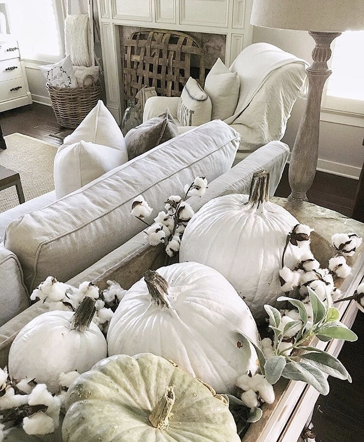 Decorating with dough bowls placed on sofa table and filled with pumpkins and cotton by She Gave It A Go