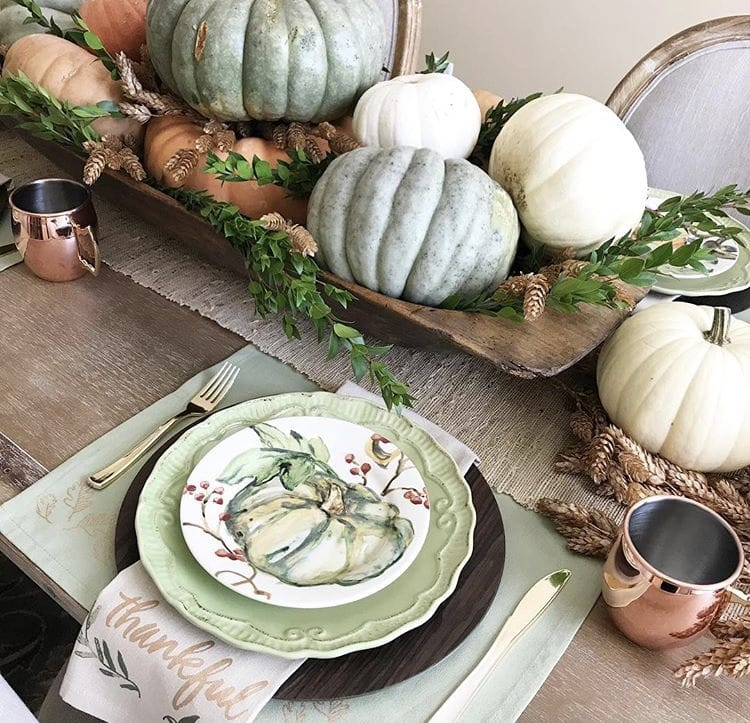 Decorating with dough bowls as a centerpiece on the dinning table filled with pumpkins and gourds by Pollies Place