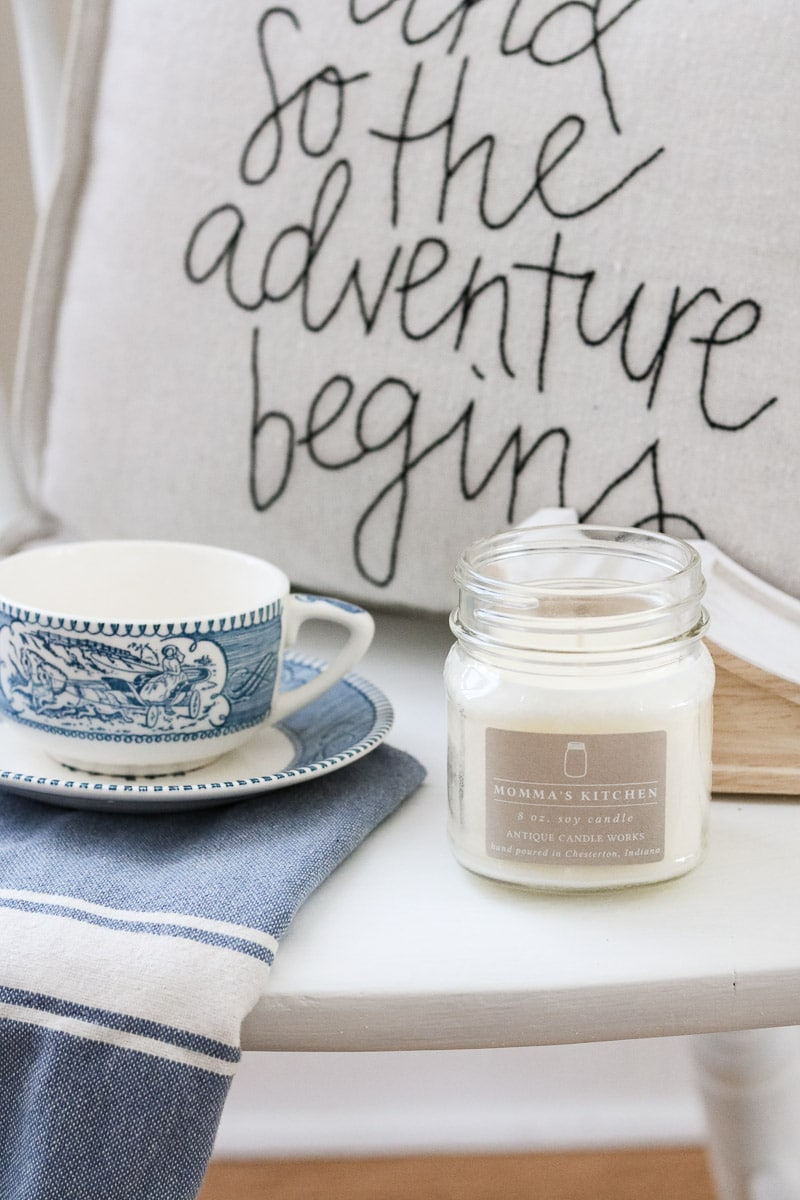 How to paint with milk paint tutorial. Photo styled with Antique Candle Works candle, and so the adventure begins pillow, currier and ives cup and saucer and blue and white stripe dish towel
