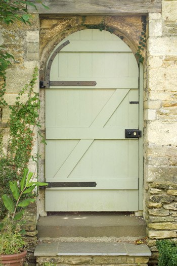 Country door in paint color Benjamin Moore Guilford Green used on a country style arched door