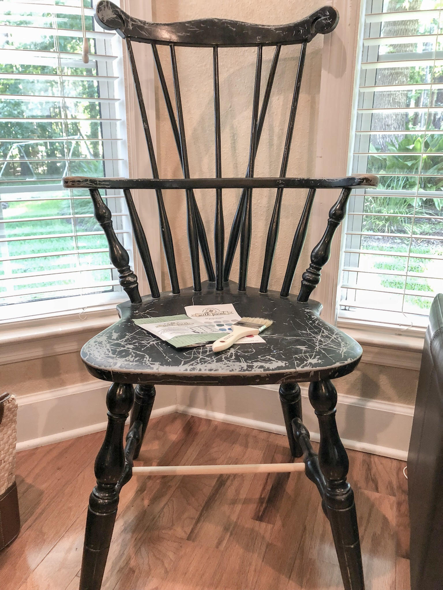 Black windsor chair that was repaired and ready to be painted with Miss Mustard Seed Paint.