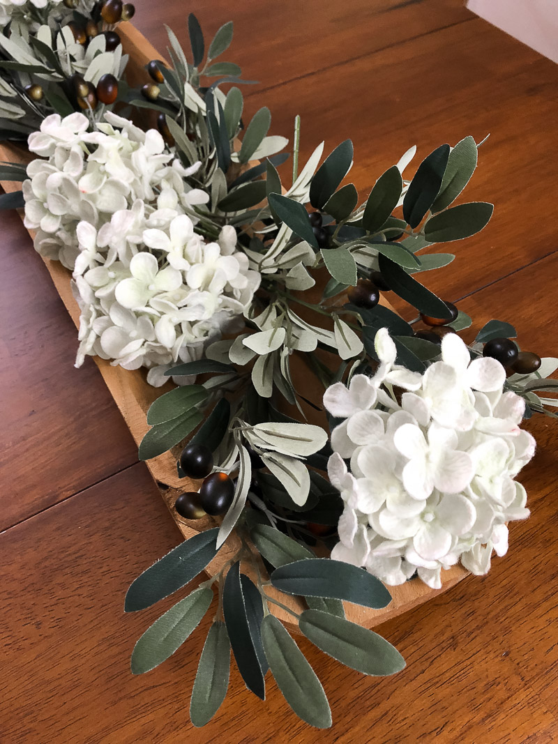 vintage dough bowl fall floral arrangement of olive branches and hydrangeas