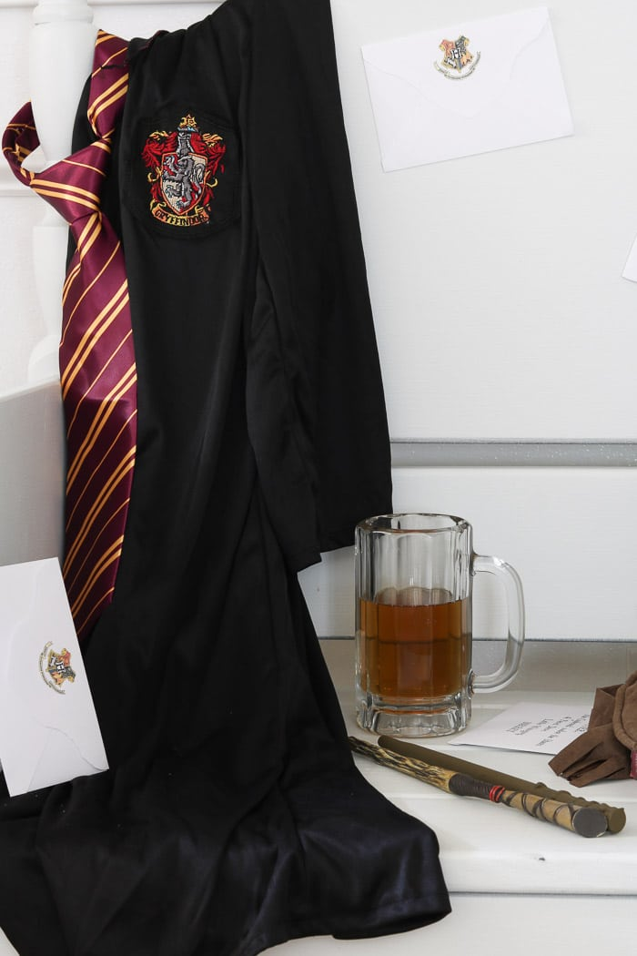 Halloween Decorations for a Harry Potter Celebration. Hogwarts uniform rob and tie. Butterbeer and wand.