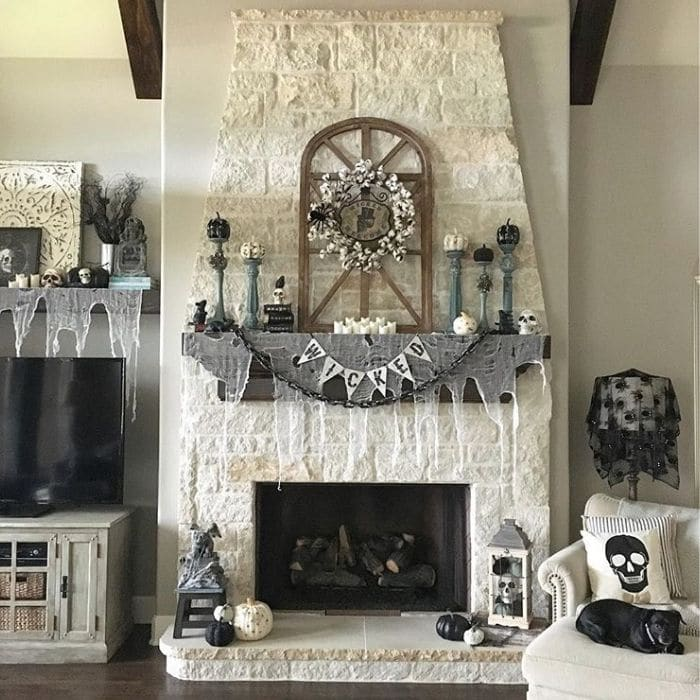 Country Halloween Decor by Stager Roz with a decorated living room and fireplace mantel