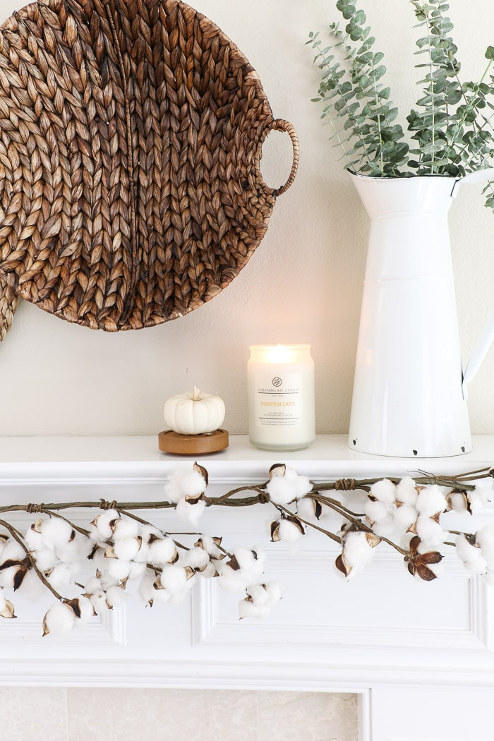 How to hang baskets on a wall for a DIY fall decor mantel design using candles and pumpkins