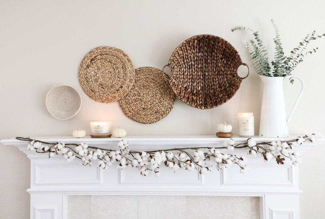 DIY fall decor mantel using wall hanging baskets, vintage pitcher, candles and pumpkins
