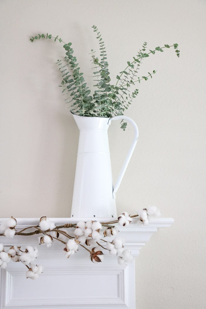 DIY fall decor mantel with a vintage french pitcher and eucalyptus
