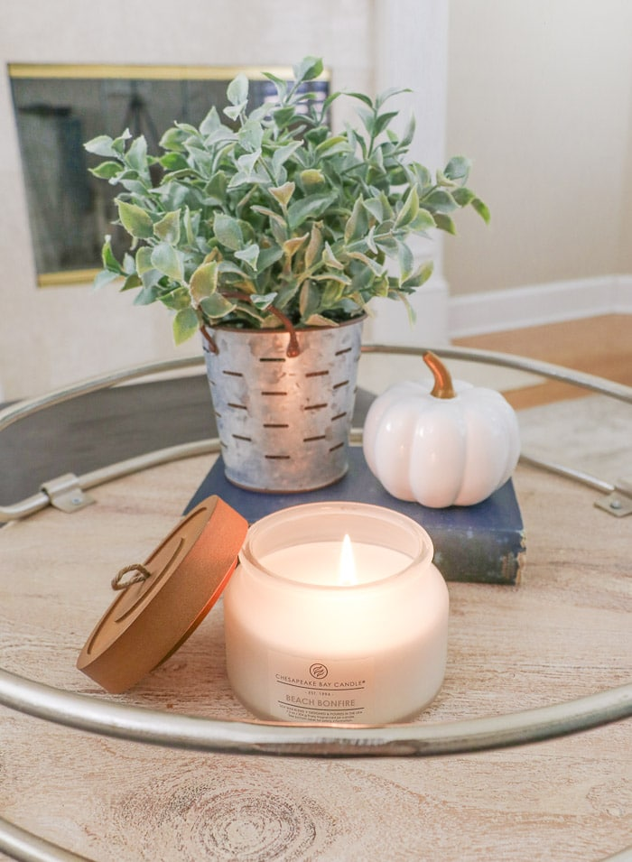 DIY fall decor idea using candles, plant, book and pumpkin on farmhouse tray
