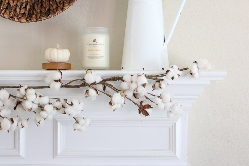 DIY fall decor mantel with baskets, candles, pumpkins, cotton garland and french vintage pitcher