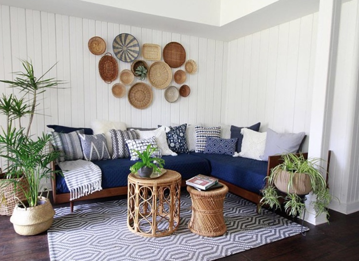 How to hang baskets on a wall by Deeply Southern Home over a daybed sofa