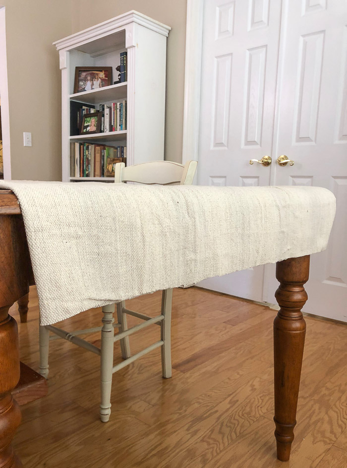DIY painters canvas drop cloth ruffled table runner holiday. Lay cloth on table