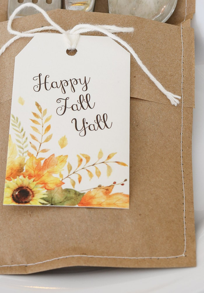 Sew along edges of folded craft paper for Thanksgiving table decorations DIY