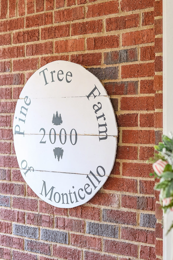 Christmas decorating ideas for front porches using a vintage tree farm sign