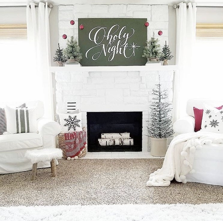 Primitive Christmas Decor by Farmhouse 165 O holy night word art above fireplace and hanging ornaments
