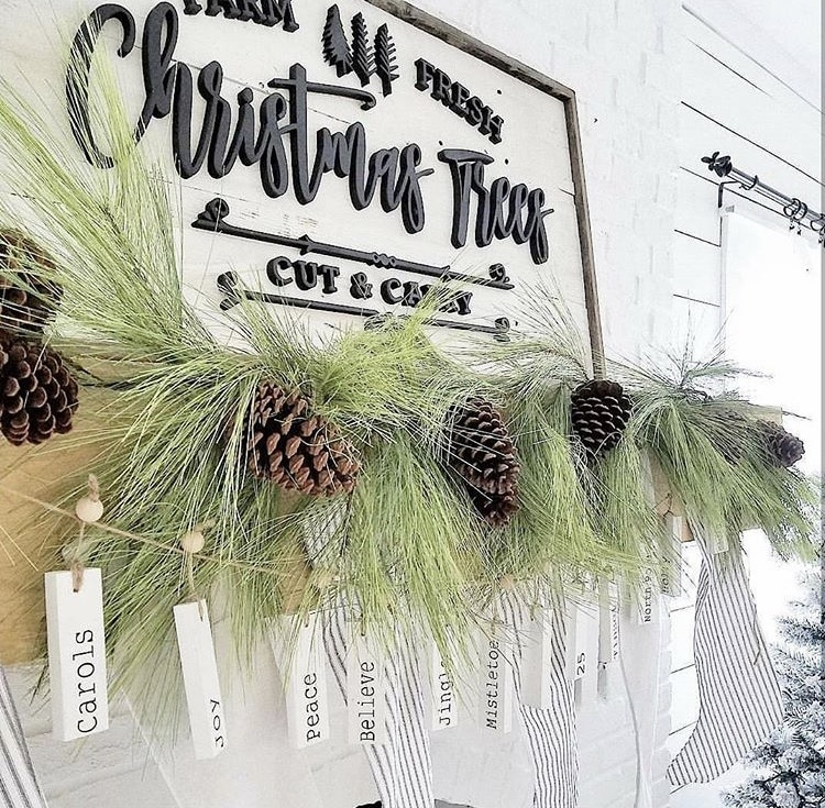 Primitive Christmas Decor by The Mtn Blue Bird Co pine trimming and pinecone garland with Christmas wooden tags