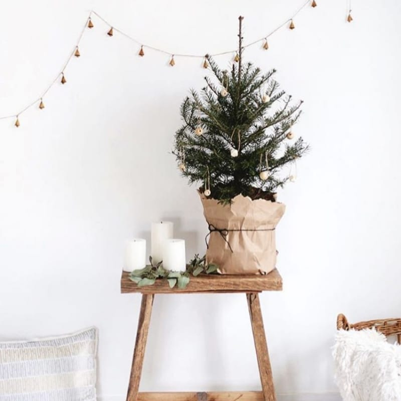 Minimalist Christmas Decorations by The Merry Thought tiny Christmas tree on stool with candles